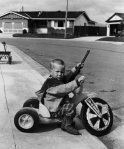 suburbia boy with gun