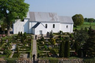 an old church and cemetery at the birthplace of Denmark - home of the Jelling Stone