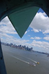 looking out of statue of liberty at Manhattan