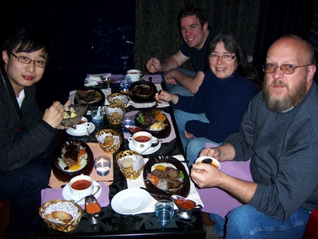 Enjoying a steak dinner with Jamie, Ann, John and Aaron before learning Mahjong