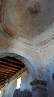 notice the fading murals on the original plaster